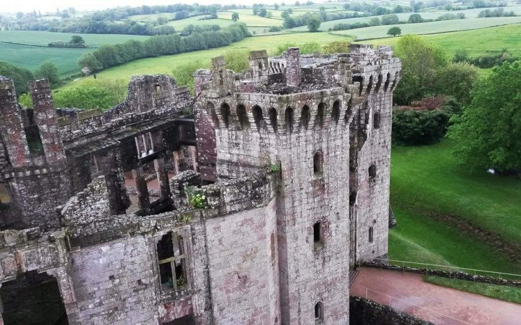 Raglan Castle, its octogonal towers and surrounding countryside