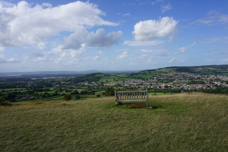 A bench with views of the Cotswold Hills and Stroud on Selsley Common