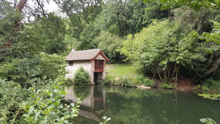 Boathouse, lake and woods in Woodchester Park near Stroud