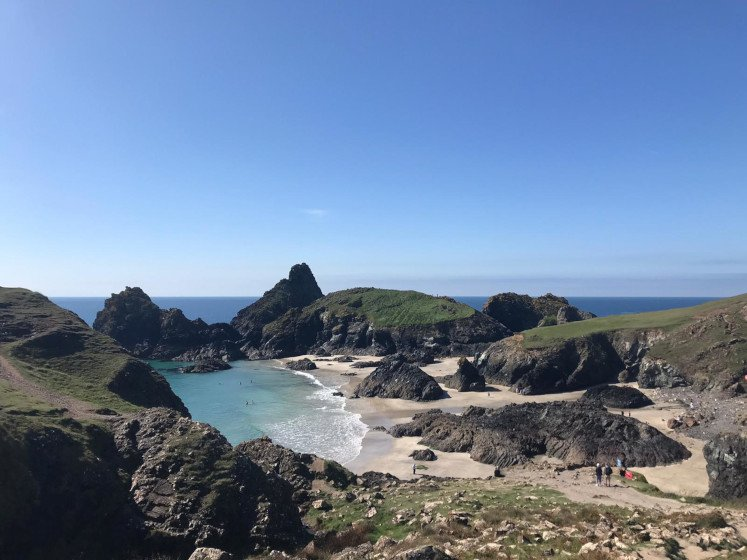 The beautiful turquoise waters, white sand and rugged cliffs of Kynance Cove on the Lizard Peninsula in Cornwall